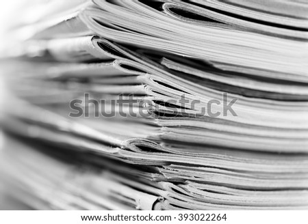 Stack of magazines with swallow depth of field, black and white photo