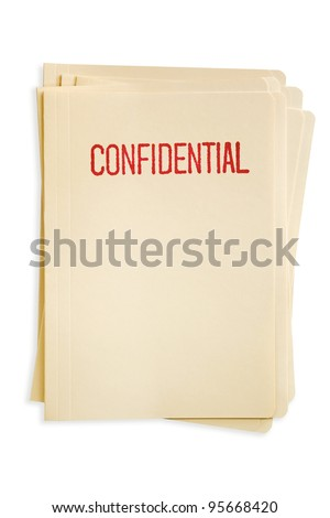 Stack of manilla file folders, stamped confidential. - stock photo