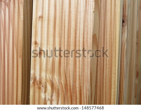 stack of many beautiful bright planks of wood riffle for the terrace - stock photo