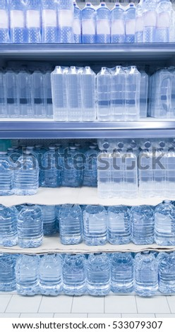 stack of many water bottles in shop