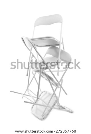 Stack of metal chairs isolated on white - stock photo