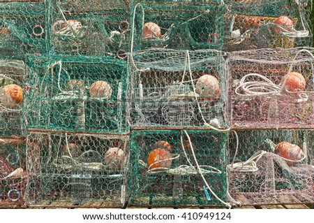 Stack of metal crab traps drying out with ropes and buoys - stock photo