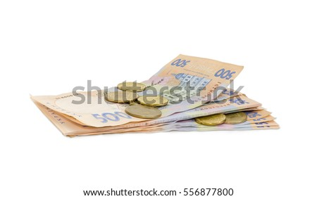 Stack of modern banknotes of Ukrainian hryvnia, some of them new and several coins from above closeup on a light background