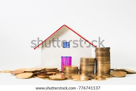 Stack of money and housing model , finance concept.