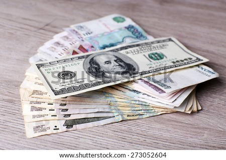 Stack of money on table close up - stock photo
