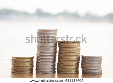 stack of money, rows of coins