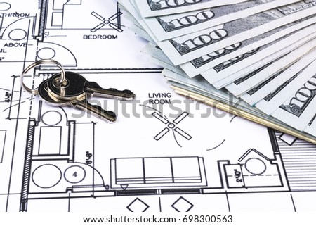 Stack money key lying on construction stock photo royalty free stack of money with key lying on construction drawing of house blueprint house plan concept malvernweather Images