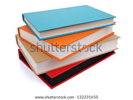 Stack of multi colored books isolated on white - stock photo