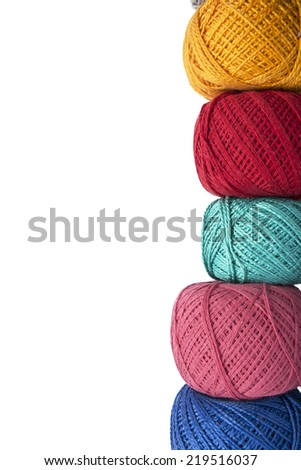 Stack of multicolor balls of yarn isolated over white as a background