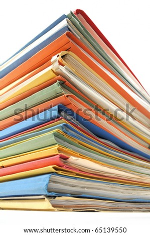 Stack of multicolored folders with documents on white background - stock photo