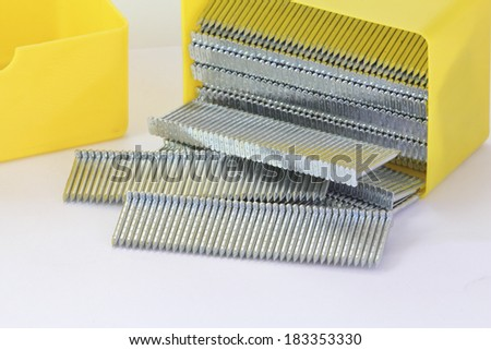 stack of nails used in a nailgun