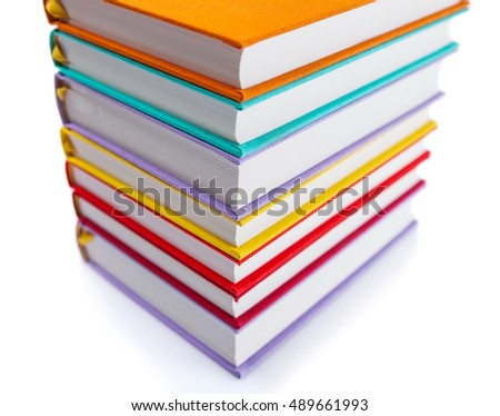 stack of new books in colorful hard cover isolated on white background