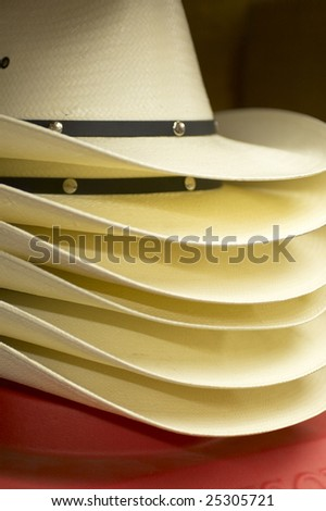 Stack of new cowboy hats. - stock photo