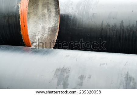 Stack of new metal pipes. Close up. - stock photo
