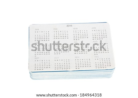 Stack of new pocket calendars to year 2015 isolated on white background - stock photo