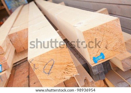 Stack of new wooden studs at the lumber yard - stock photo