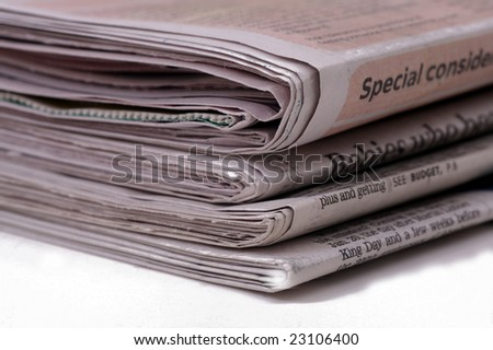Stack of newspapers - stock photo