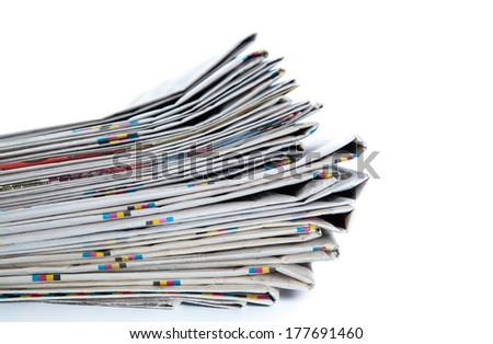 stack of newspapers close-up on white