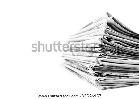 Stack of newspapers in black and white isolated - stock photo