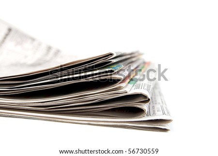 Stack of newspapers.  Isolated on white background. - stock photo