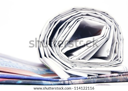 Stack of newspapers on white