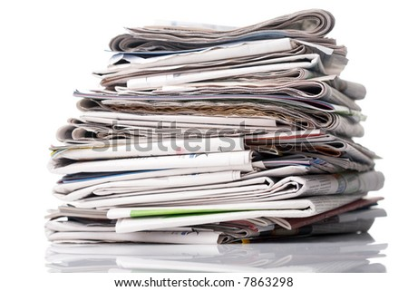 Stack of newspapers on white background - stock photo
