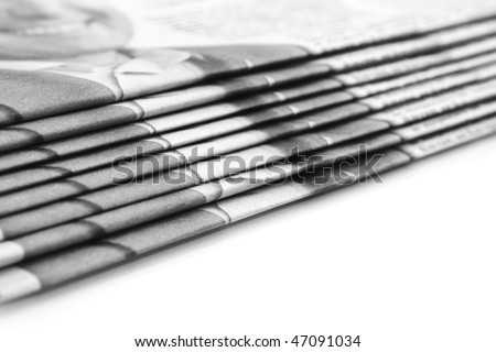Stack of newspapers over white (Shallow DOF) - stock photo