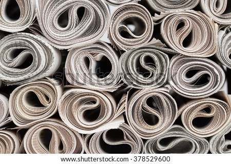 Stack of newspapers rolls, paper texture background. - stock photo
