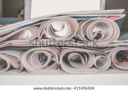 Stack of newspapers rolls, selective focus - stock photo