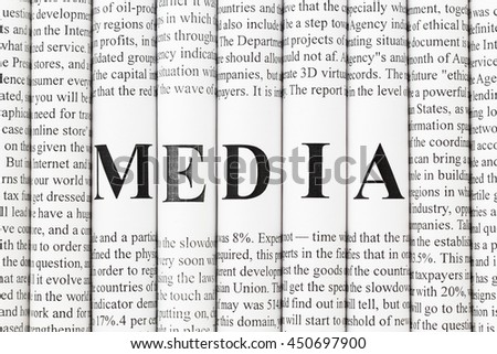 "Stack of newspapers with small text and big letters forming together word ""MEDIA"" - stock photo"