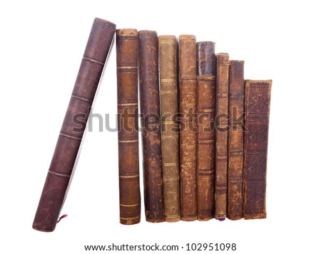 Stack of nine antique books, isolated white background