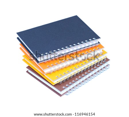 Stack of notebooks isolated on white background - stock photo