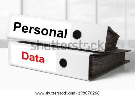 stack of office binders personal data