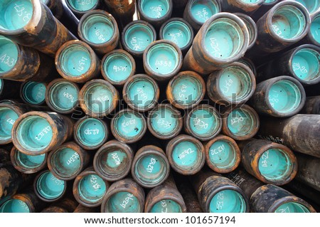 Stack of oil well casing bundles at the pin end of casing - stock photo