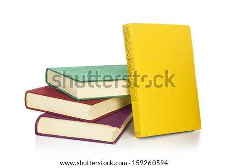 Stack of old antique books isolated on white - stock photo