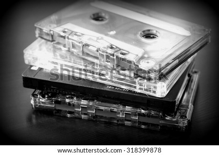 Stack of old audio tapes on a dark wooden background close up - stock photo