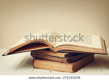 Stack of old big books. Color toning applied. - stock photo