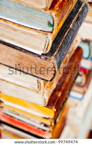 stack of old books. antique books background - stock photo