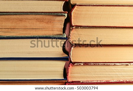 Stack of old books background