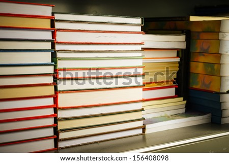 Stack of old books in shelf