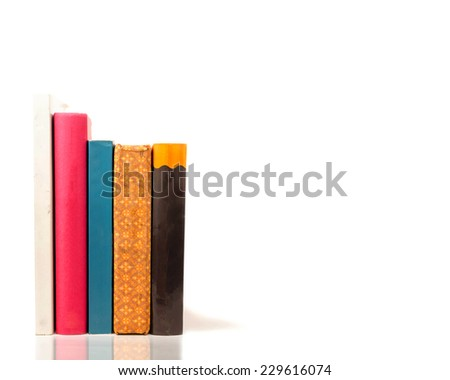 stack of Old books isolated on white,Stack of colorful books and E-book on white background - stock photo