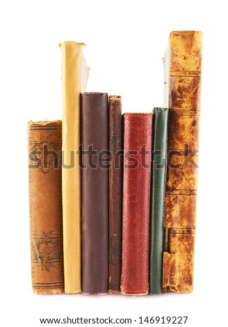 Stack of old books, spines forward, isolated over white background