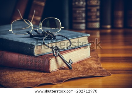 Stack of old books, vintage style - stock photo