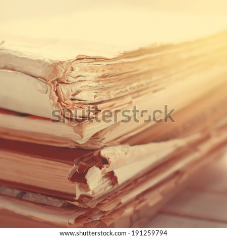 Stack of Old Books with Tattered Pages, close up, toned image, square - stock photo
