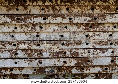 Stack of old brown iron rust background - stock photo