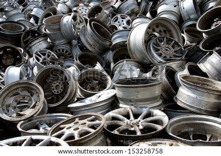 Stack of old discarded wheels - stock photo