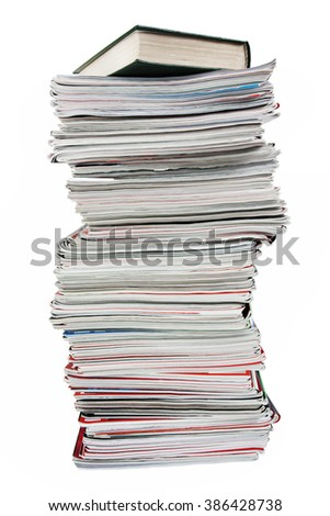 Stack of old magazines and a book on  white background