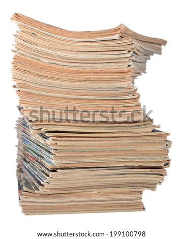 Stack of old magazines on a white background - stock photo