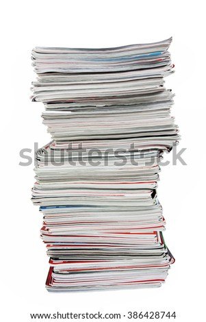 Stack of old magazines on  white background - stock photo