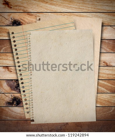 stack of old paper on wood textures background